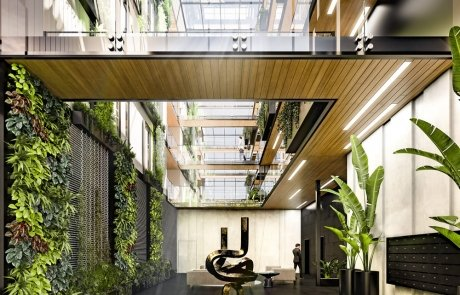 Nicola Manning Design Browns Bay beach apartments entryway with green walls and open atrium, timber soffits.