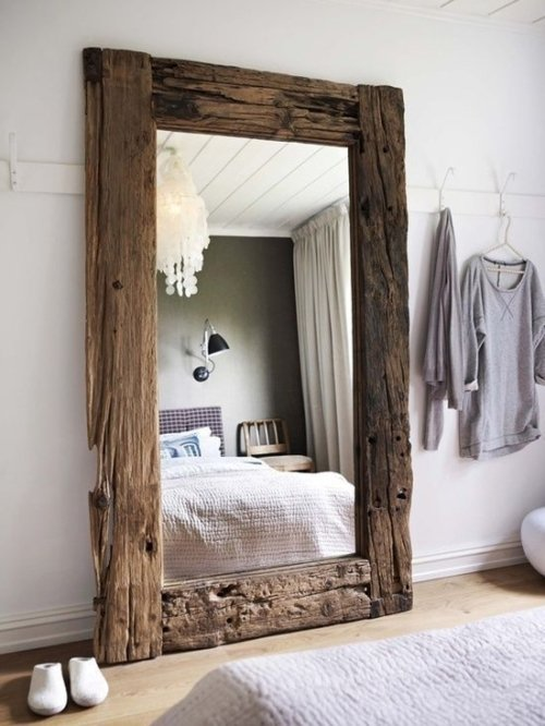 Large driftwood frame stand alone mirror in bedroom