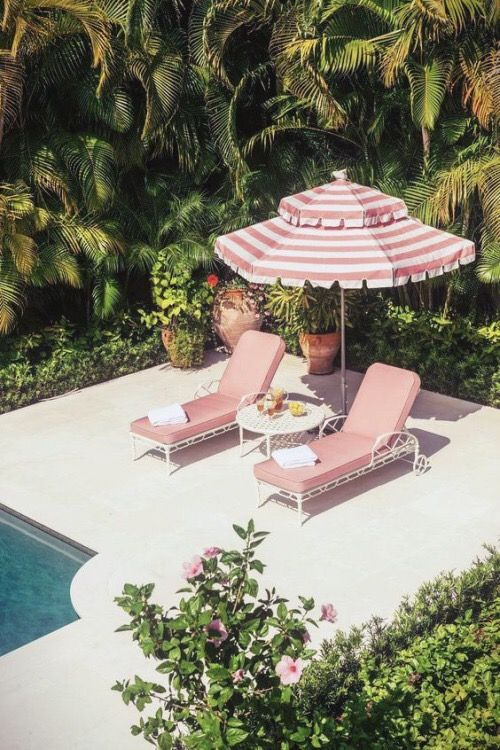 Nicola Manning Design Blog pink pool loungers and striped pink sun umbrella