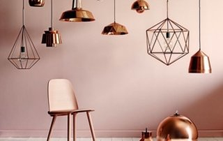 Nicola Manning Design Blog, pink wall and chair and copper pendant lights